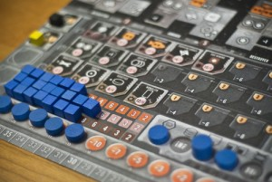 This shot from Board Game Geek shows off a section of a player sheet with influence track at the bottom, materials to the left and actions on the right.