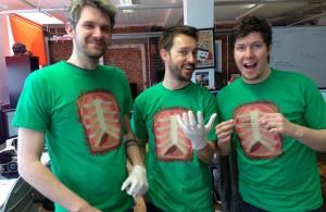 Surgeon Sim T-shirts modelled by  developers Tom Jackson, James Broadley and Luke Williams of Bossa Studios
